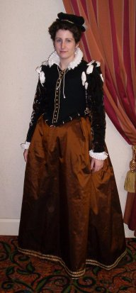 Front view of 16th century doublet and bronze silk taffeta skirt.