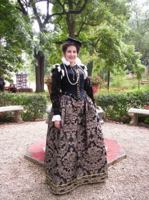 Front view of 16th century doublet and black brocade skirt.